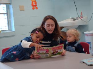 Alicia reading to the kids.